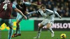 Michu of Swansea City gets away from Mark Noble of West Ham United but neither side can find a breakthrough and the game ends 0-0