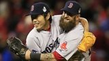 Koji Uehara of the Boston Red Sox celebrates with teammate Mike Napoli after victory over St Louis Cardinals in game four of the 2013 World Series at Busch Stadium