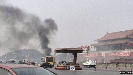 Vehicles travel along Chang'an Avenue as smoke rises at Tiananmen Square in Beijing, China, 28 October 2013