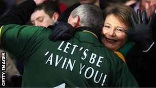 Norwich City's outspoken director Delia Smith waves as she hugs a fan after her speech to the fans in 2005.