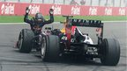 Sebastian Vettel bows before his car after winning the Indian Grand Prix to take the 2013 world title