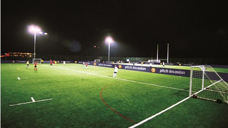 A floodlit football pitch