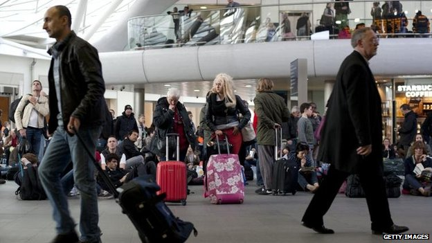 Passengers wait on concourse at King's Cross station after train services were cancelled