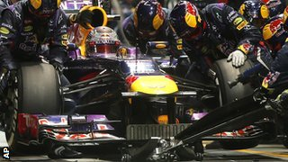 Sebastian Vettel having tyres changed