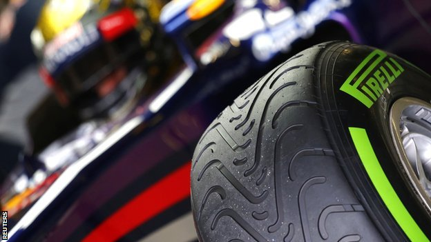 Sebastian Vettel with tyre in foreground