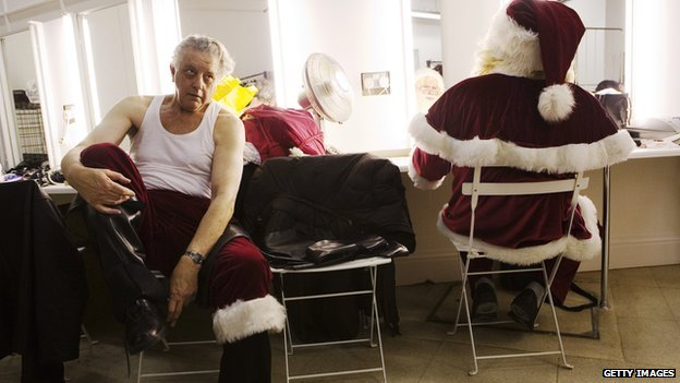 Santas getting dressed