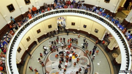 Protesters line the floors of the rotunda at the State Capitol building during a protest before the start of a special session of the Legislature in Austin, Texas 1 July 2013
