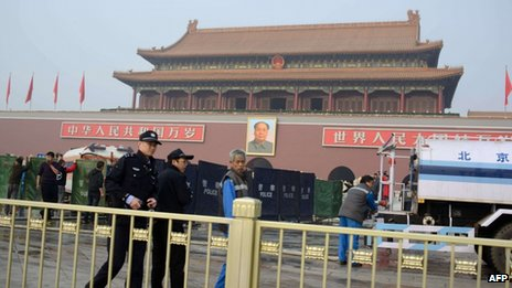 Policemen walk past barriers and fire vehicles outside Tiananmen Gate in Beijing on 28 October 2013