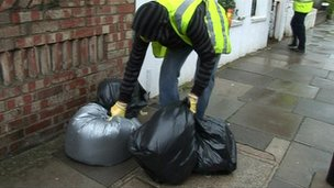Dustbin man collecting bin bags