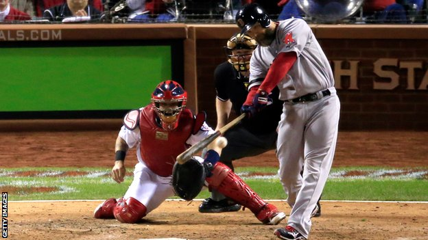 David Ross of the Boston Red Sox hits a ground rule double in the seventh inning as Yadier Molina of the St Louis Cardinals looks on