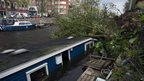 An uprooted tree on top of a houseboat at the Jacob van Lennepkade canal in Amsterdam (28 October 2013)