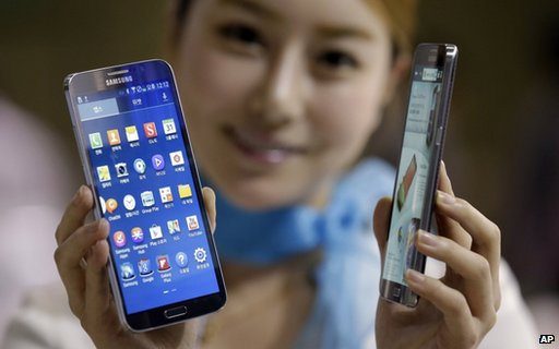 Model poses with Samsung smartphones