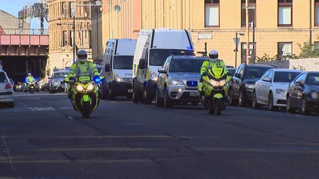 Police vans on their way to the court