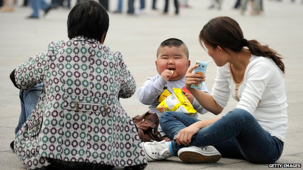 A family visiting Tiananmen Square - file pic, Sep 2012