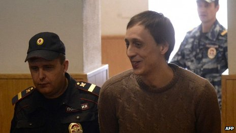 Pavel Dmitrichenko is escorted into Tuesday's court hearing