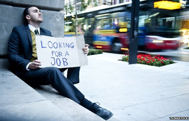 Man with a sign saying he is looking for a job