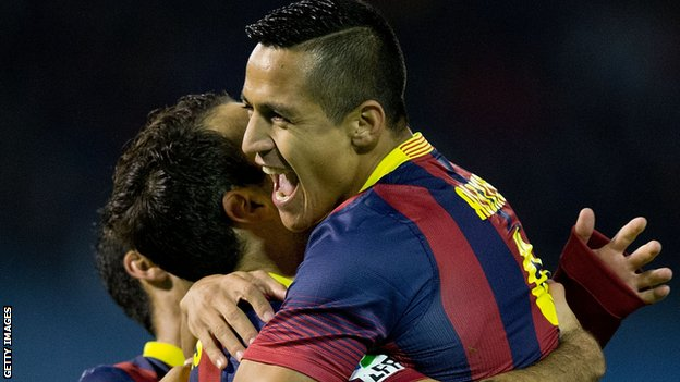 Alexis Sanchez of Barcelona celebrates scoring their opening goal against Celta Vigo
