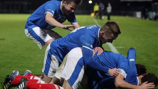 Linfield celebrate scoring against Cliftonville in County Antrim Shield semi-final