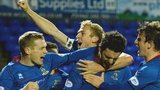 Inverness Caledonian Thistle players celebrate Ross Draper's last-gasp winner