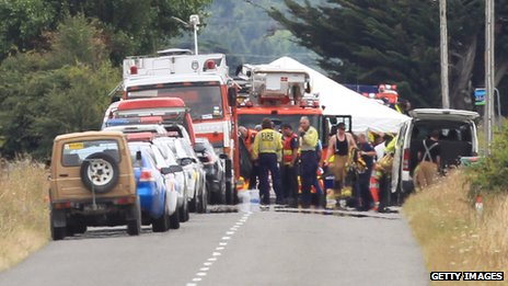 A Police photographer is lifted up in a Fire service ladder unit at the hot air balloon accident site on 7 January 2012 in Carterton, New Zealand