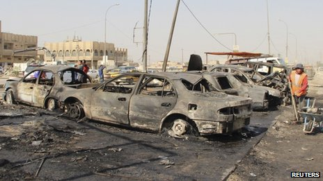 The scene of a car bomb blast in Baghdad's al-Shaab district (27 October 2013)