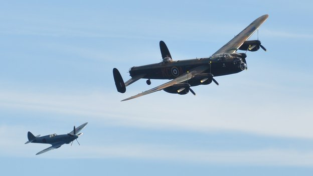 Battle of Britain Memorial Flight Lancaster and Spitfire taking part in Guernsey's air display in 2012