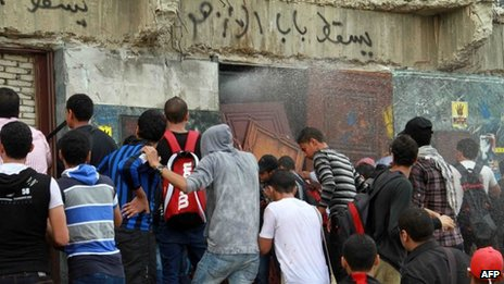 Egyptian students of al-Azhar University block the access to an administration building during an anti-army protest