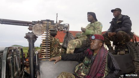 Congolese soldiers arrive on a truck at Rumangabo military base, formerly held by M23 rebels, north of Goma, on 28 October 2013