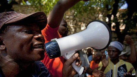 Demonstrators chant slogans outside the Dominican Republic's embassy in Petion-Ville on 8 October, 2013