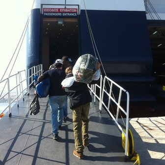 Immigrants board the ferry leaving Lesvos for Athens