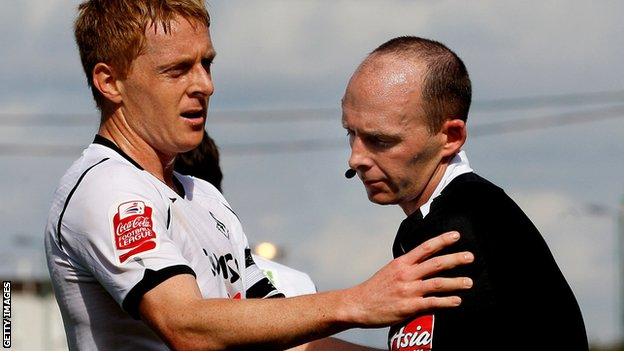 Referee Mike Dean with Swansea's Garry Monk