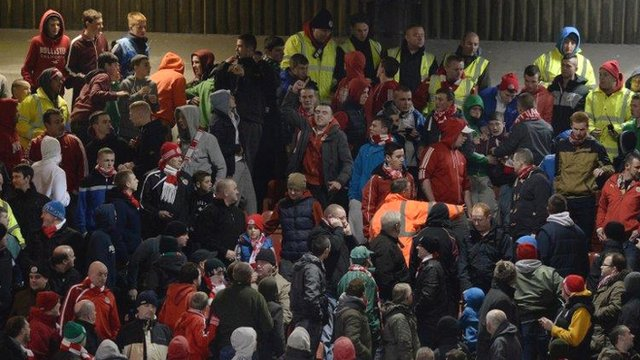Stewards move into the Cliftonville end