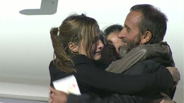 One of the hostages arriving in France