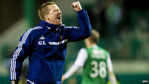 A jubilant Gary Locke salutes the Hearts fans