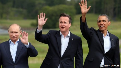 Vladimir Putin, David Cameron and Barack Obama wave to the camera