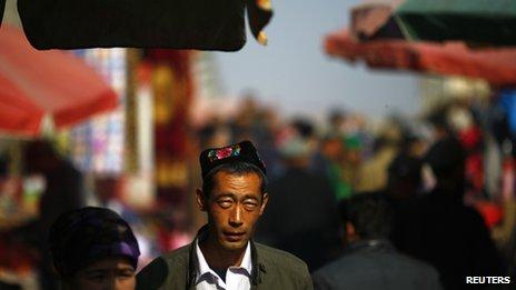 An ethnic Uighur man walks along a market in downtown Turpan, Xinjiang province 31 October 2013