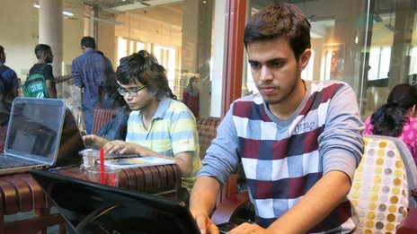 Utkarsh Malhotra using a laptop