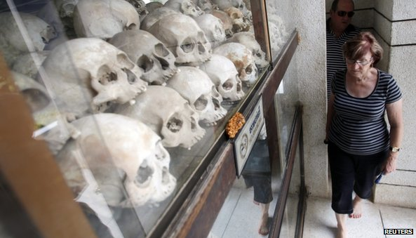 "Tourists visit at a memorial stupa with bones of more than 8,000 victims of the Khmer Rouge regime at Choeung Ek, a ""Killing Fields"" site located on the outskirts of Phnom Penh"