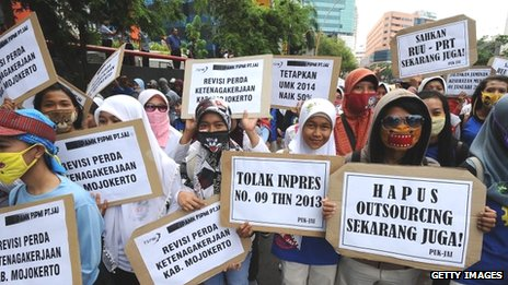 Workers protest to demand higher wages on 31 October 2013 in Surabaya