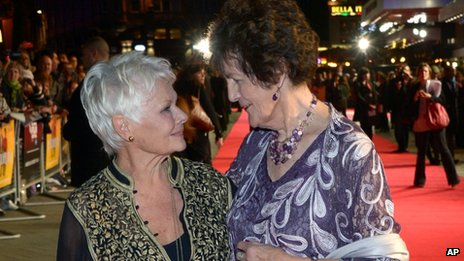Dame Judi Dench (left) with Philomena Lee on the red carpet in London