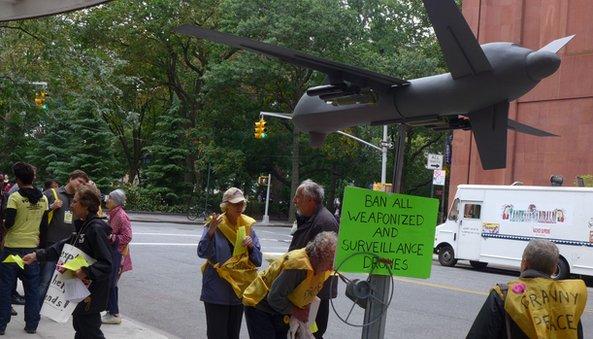 Protestors and drone