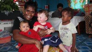 Lemba, who Madeleine interviewed, with Scarlett and her own children
