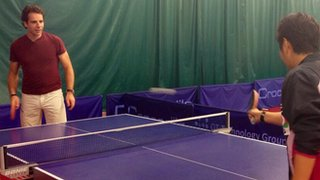 Mark Beaumont plays table tennis with Jing Jun Hong