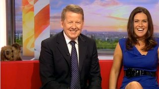 Hacker pops into shot on BBC Breakfast behind Bill Turnbull and Susanna Reid