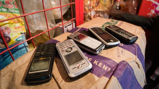 Mobile phones on money kiosk