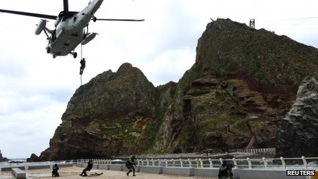 Members of South Korean security forces take part in a drill at a set of remote islands called Dokdo in Korean and Takeshima in Japanese on 25 October 2013