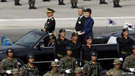 South Korean President Park Geun-hye (R on vehicle) and Defence Minister Kim Kwan-jin (C) inspect troops on Armed Forces Day on 1 October 2013