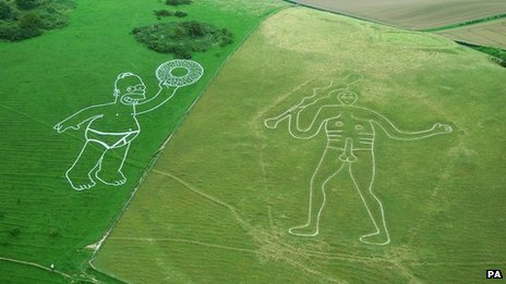 Giant Homer Simpson appears at Cerne Abbas