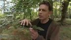 Chris Packham with tree branch