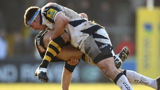 Nic Berry is tackled by Sale's Neil Briggs while playing for Wasps